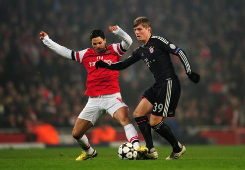 Mikel Arteta iin action against Toni Kroos of Bayern Muenchen last night