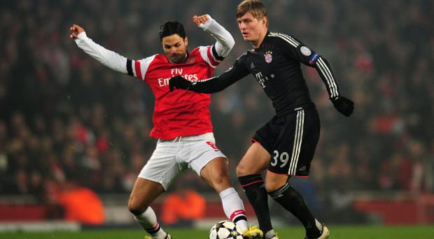 Mikel Arteta of Arsenal in action against Toni Kroos of Bayern