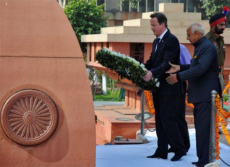 Britain's Prime Minister David Cameron places a wreath at the Jallianwala Bagh memorial in the northern Indian city of Amritsar