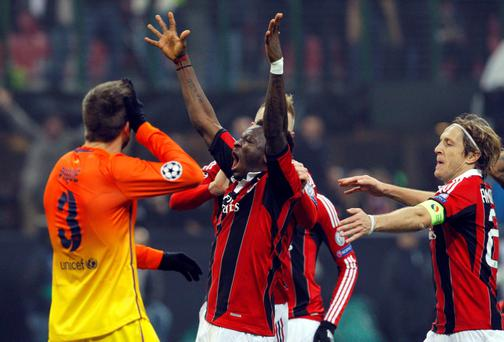 AC Milan's Sulley Muntari (C) celebrates with teammates after scoring against Barcelona