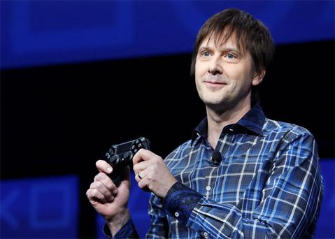 PlayStation 4's lead system architect Mark Cerny holds a gaming control device during the unveiling of the PlayStation 4 launch event in New York