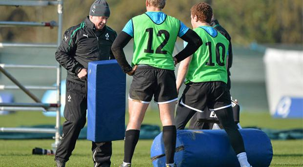 Irish coach Declan Kidney keeps a close eye on Ulster pair Luke Marshall and Paddy Jackson during training yesterday