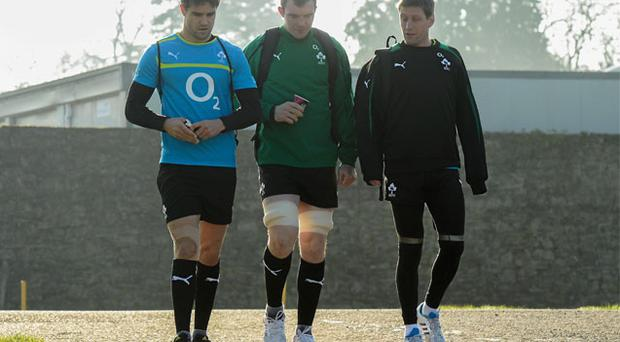 Ronan O'Gara (right) walks to training yesterday with fellow Munster men Conor Murray and Peter O'Mahony