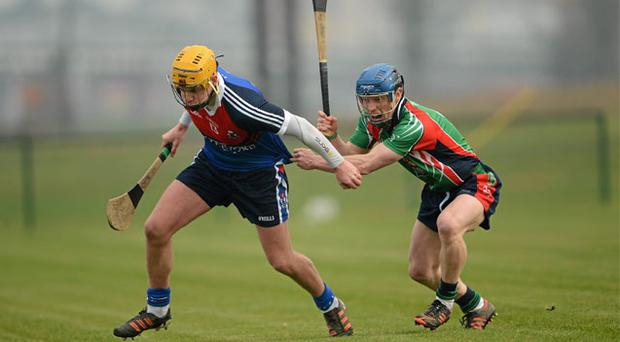 Martin O'Neill of Waterford IT tries to get away from the shackles of Limerick IT's Eoin O'Sullivan during the Fitzgibbon Cup quarter-final at Carriganore yesterday