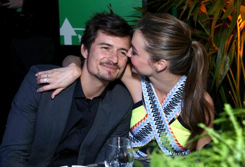 HOLLYWOOD, CA - FEBRUARY 20: Actor Orlando Bloom (L) and Miranda Kerr attend Global Green USA's 10th Annual Pre-Oscar Party at Avalon on February 20, 2013 in Hollywood, California. (Photo by Alexandra Wyman/Getty Images for Global Green)