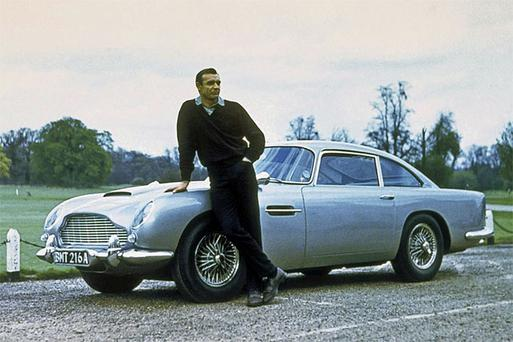 Sean Connery as James Bond with the Aston Martin DB5, which has been put up for sale by former billionaire Thomas Straumann.