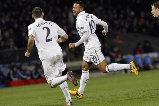 Mousa Dembele celebrates with Clint Dempsey, left, after his goal