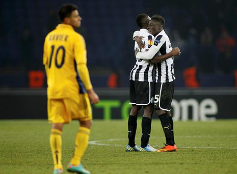 Newcastle United's Mapou Yanga-Mbiwa (2nd R) and team mate Massadio Haidara (R) celebrate their victory over Metalist Kharkiv