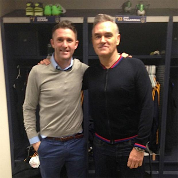 Football legend Robbie Keane, left, with his distant cousin, singer Morrissey, after the LA Galaxy pre-season match