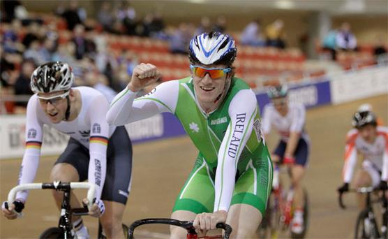 Ireland's Martyn Irvine celebrates the gold medal during the men's scratch race final at the 2013 UCI Track Cycling World Championships in Minsk