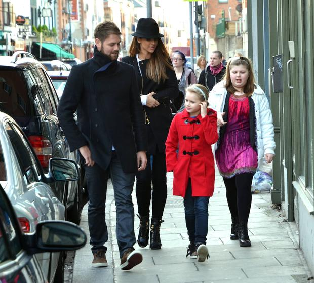 Brian McFaddden & wife Vogue Williams take Brian's daughters Molly & Lily Sue to see the 'Snow White & The Adventures of Sammy Sausages' panto at The Tivoli Theatre, Dublin, Ireland - 03.01.13. Pictures: VIPIRELAND.COM *** Local Caption *** Brian McFadden, Vogue Williams, Molly McFadden, Lily Sue McFadden