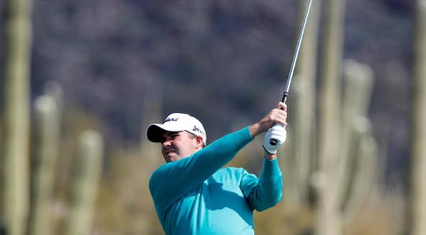 Shane Lowry of Ireland hits his second shot on the first hole during the second round of the WGC-Accenture Match Play Championship golf tournament in Marana, Arizona