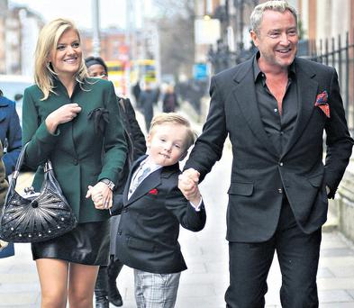 Lord of the Dance Michael Flatley leaving Government Buildings with his wife Niamh and son Michael.