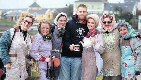 Rob Morgan, the son of late Father Ted star Dermot, enjoys a cup of tea with half-a-dozen Mrs Doyles – Carol McCabe, Lorraine Redmond, Sorcha Brady, Gerarde Mackey, Anna Leonard and Sara Kheradmand – at the seventh annual Tedfest on Inis Mor, Co Galway.