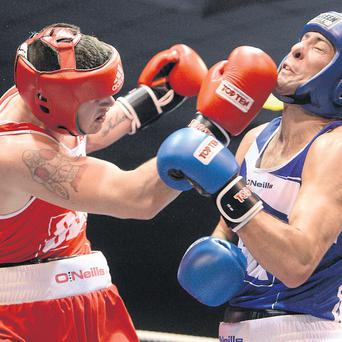 Joe Ward and Ken Egan exchange punches during their fight in the National Stadium