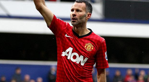 Manchester United's Ryan Giggs celebrates after scoring his side's second goal of the game