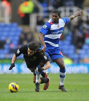 Reading's Mikele Leigertwood and Wigan Athletic's Jordi Gomez (left) battle for the ball