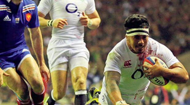 England's Manu Tuilagi goes over the line to score his try against France at Twickenham