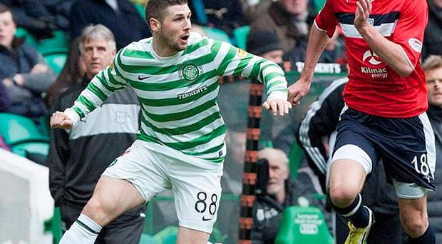 Celtic's Gary Hooper vies for the ball with Dundee's Declan Gallagher