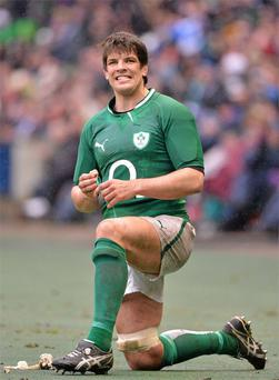 Donncha O'Callaghan grits his teeth as he looks on from the sidelines after being substituted late in the game