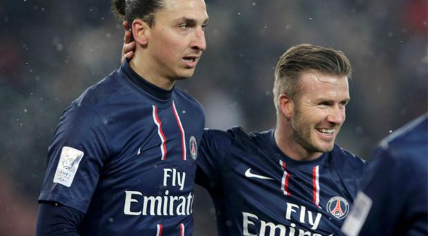 Paris Saint-Germain's David Beckham (R) congratulates Zlatan Ibrahimovic after his goal against Olympic Marseille