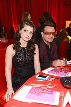 WEST HOLLYWOOD, CA - FEBRUARY 24: Musician Bono (R) and actress Eve Hewson attends the 21st Annual Elton John AIDS Foundation Academy Awards Viewing Party at Pacific Design Center on February 24, 2013 in West Hollywood, California. (Photo by DRos Kambouris/Getty Images for EJAF)