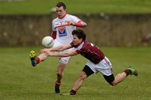Louth's Conor McGuinness gets his kick away despite the best efforts of Galway's Gary Sweeney in the Allianz NFL Division 2 at Drogheda on Saturday