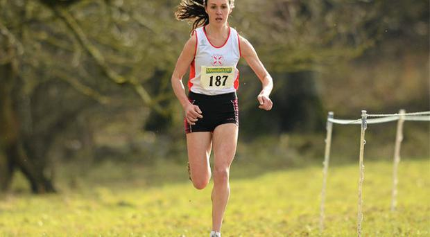 Mary Cullen of Sligo AC leads the field on her way to winning the senior women's 8,000m at the Woodie's DIY Inter Club Cross Country Championships