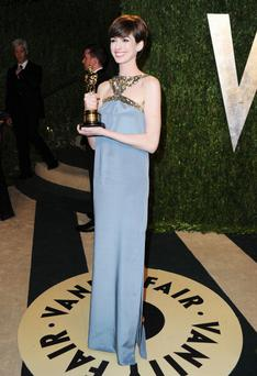 WEST HOLLYWOOD, CA - FEBRUARY 24: Actress Anne Hathaway arrives at the 2013 Vanity Fair Oscar Party hosted by Graydon Carter at Sunset Tower on February 24, 2013 in West Hollywood, California. (Photo by Pascal Le Segretain/Getty Images)