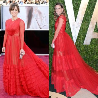 Their tiered, floor-sweeping, long-sleeve red silk chiffon gowns looked to be one in the same design