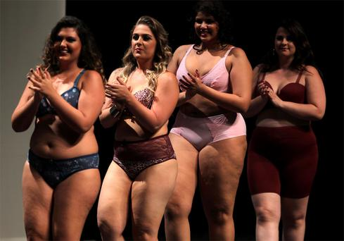 Models walk the runway during a presentation as part of Fashion Weekend Plus Size Autumn/Winter 2013 collection show in Sao Paulo