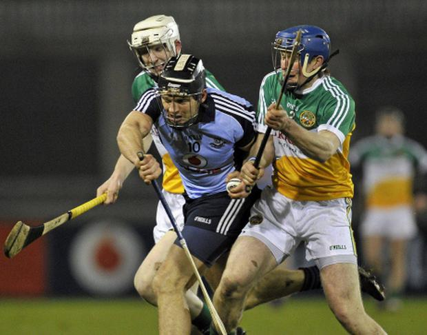Conal Keaney, Dublin, in action against Sean Gardine, left, and Chris McDonald, Offaly. Picture: Daire Brennan / SPORTSFILE