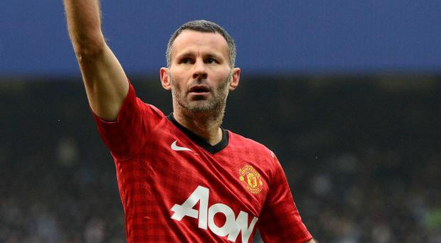 Manchester United's Ryan Giggs celebrates scoring against Queens Park Rangers