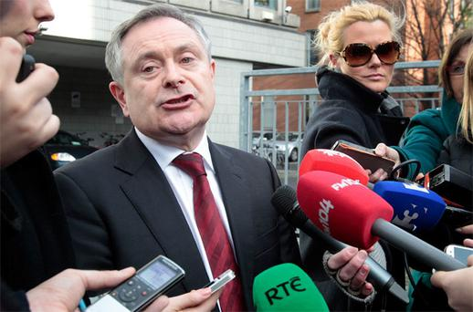 Public Expenditure Minister Brendan Howlin speaks to the media outside Lansdowne House