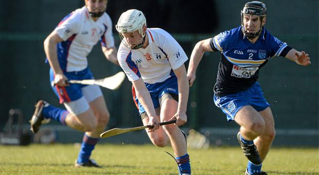 Brian O'Halloran of Mary Immaculate College (left) in action against DIT's Jamie Divney