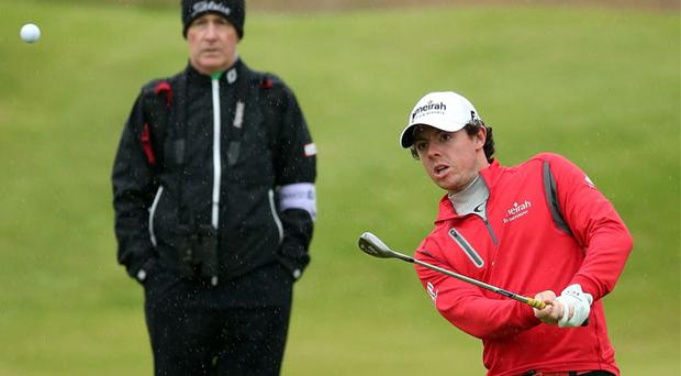 Michael Bannon keeps a close eye on Rory McIlroy at Lytham & St Annes last summer - Bannon is currently working with the Holywood star in Florida
