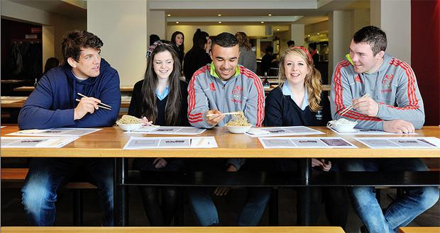 Donncha O'Callaghan, Simon Zebo and Peter O'Mahony pictured with students Joanne Moloney and Sarah Fitzpatrick from St. Mary's Secondary School, Mallow during a class on food safety, kitchen skills and healthy eating.