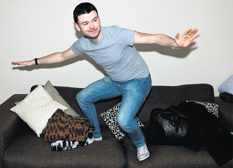 Ben takes couch surfing a little too literally on Ben Trivett's sofa