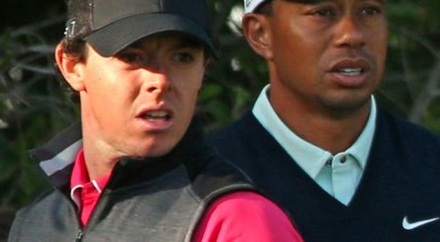 Rory McIlroy and Tiger Woods of the USA pictured during the first round of The Abu Dhabi HSBC Golf Championship