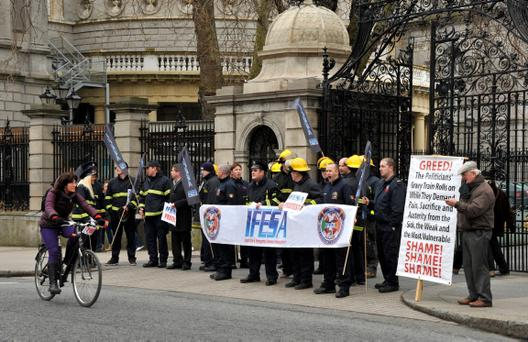 Dublin Fire Brigade members of the IFESA Irish Fire and Emergency Services Association - protest against the new public sector pay deal outside Leinster House
