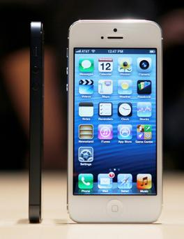 The iPhone 5 on display after its introduction during Apple Inc.'s iPhone media event in San Francisco...The iPhone 5 on display after its introduction during Apple Inc.'s iPhone media event in San Francisco, California September 12, 2012. REUTERS/Beck Diefenbach (UNITED STATES - Tags: SCIENCE TECHNOLOGY) ...A