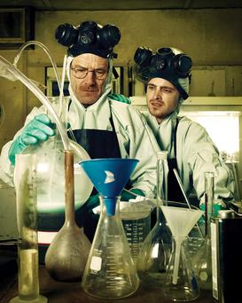 Actors Bryan Cranston and Aaron Paul portraying Walter White and Jesse Pinkman in the hit American television series Breaking Bad.