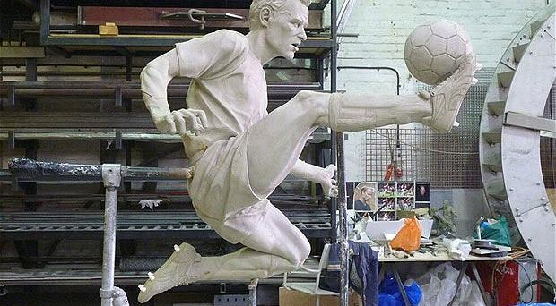 Touch of a master: Dennis Bergkamp will have a statue outside the Emirates Stadium