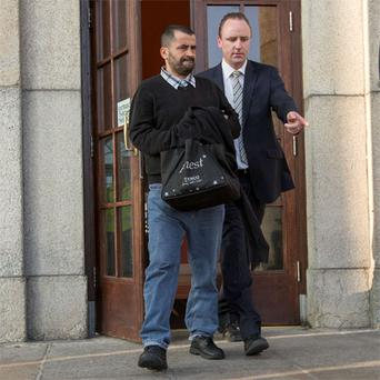 Ali Charaf Damache (left) leaving Waterford Circuit Court after he pleaded guilty to sending a menacing phone message to a US lawyer