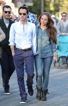 Marc Anthony and new girlfriend Chloe Green in Disneyland. (Photo by Jason Merritt/FilmMagic)
