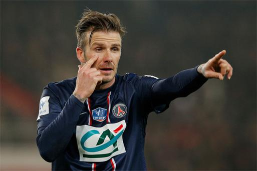David Beckham of PSG signals to a team mate during the French Cup match between Paris Saint-Germain FC and Marseille