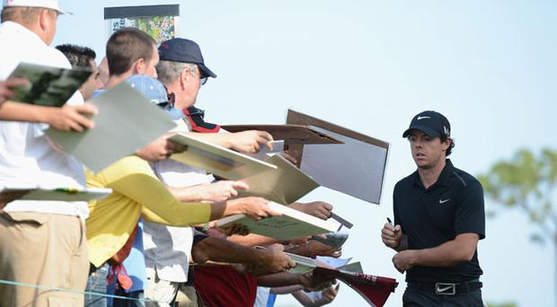 Rory McIlroy signs autographs during the Honda Classic pro am at PGA National in West Palm Beach yesterday