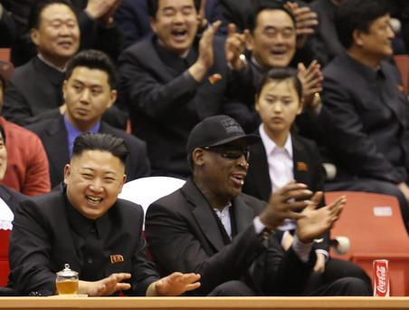 North Korean leader Kim Jong Un, left, and former NBA star Dennis Rodman watch North Korean and U.S. players in an exhibition basketball game at an arena in Pyongyang, North Korea,