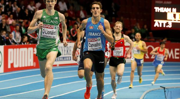 Ciaran O'Lionaird of Ireland wins his heat ahead of Florian Carvalho (R) of France in the 3000m Men Round 1 event at the European Athletics Indoor Championships in Goteborg March 1, 2013.