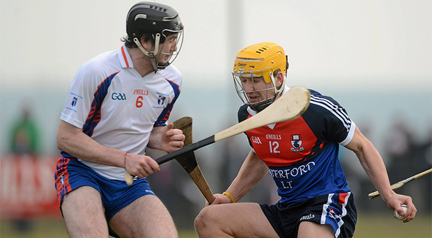 Eoin Murphy, Waterford Institute of Technology, is challenged by Declan Hannon, Mary Immaculate College, Limerick
